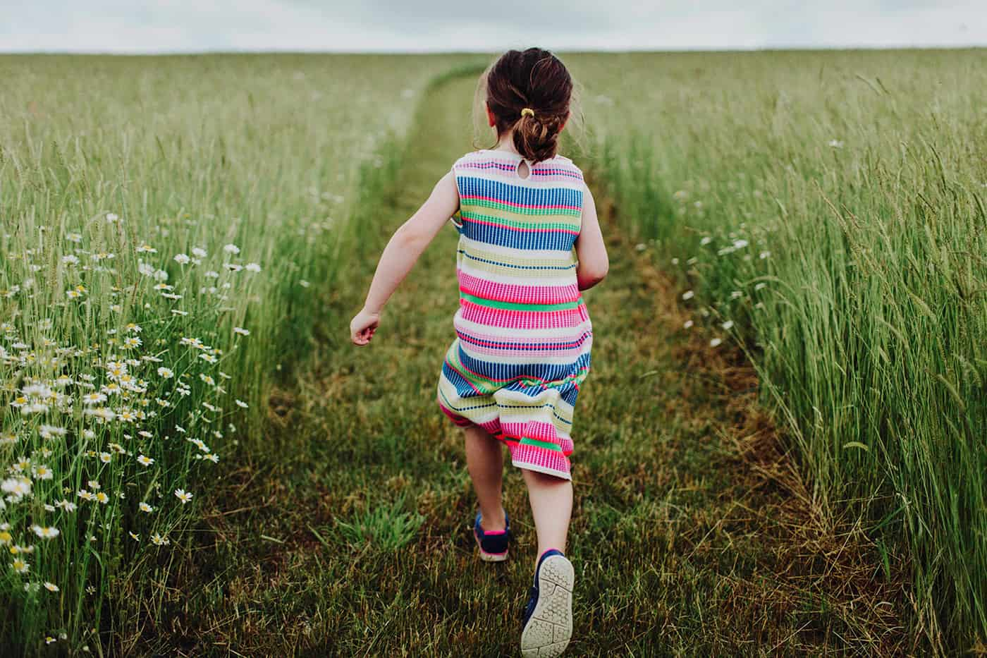girl running in field