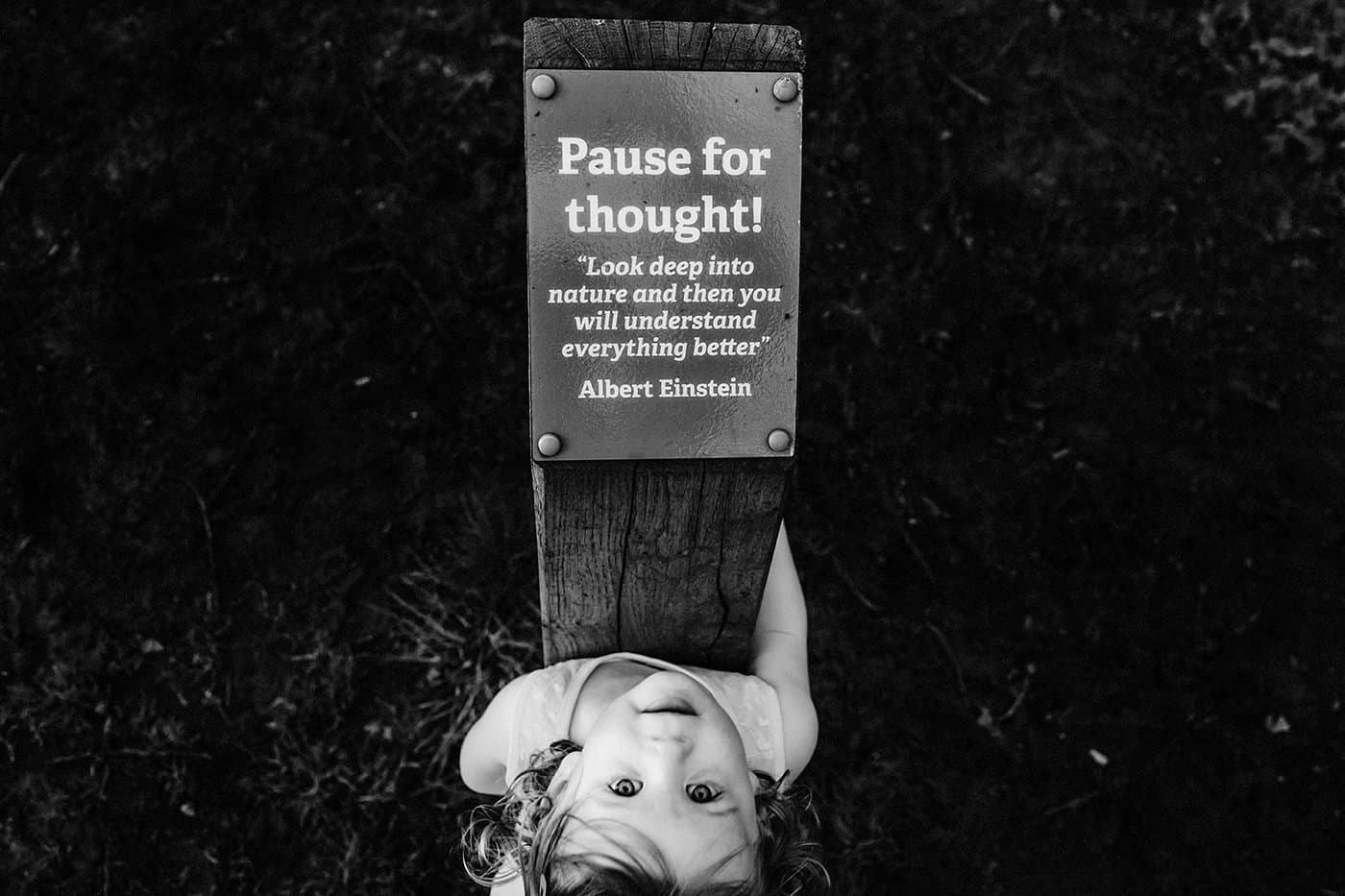 Child poses by Einstein quote