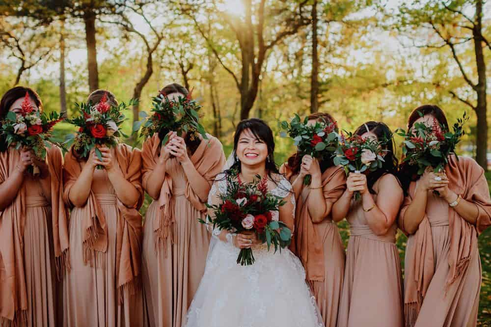 Fun portrait of bride with bridesmaids in Montreal