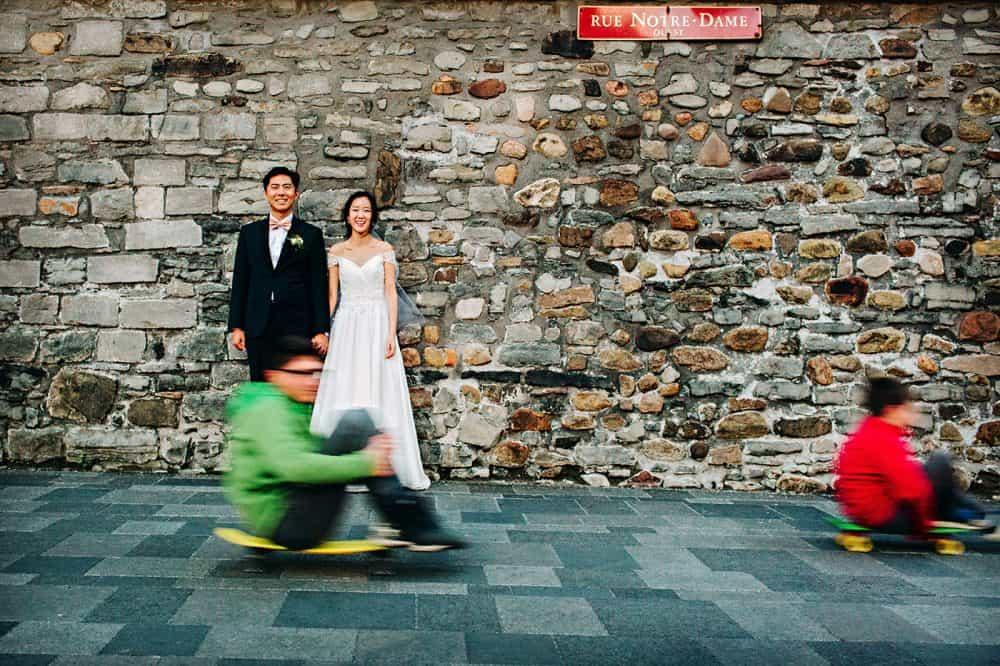 Bride & groom with skateboarders