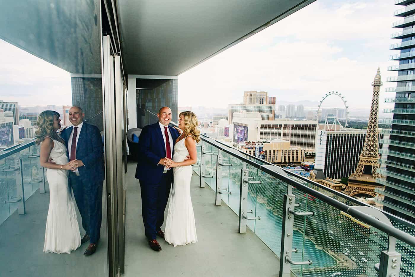 Bride and groom on Cosmopolitan hotel balcony in Las Vegas