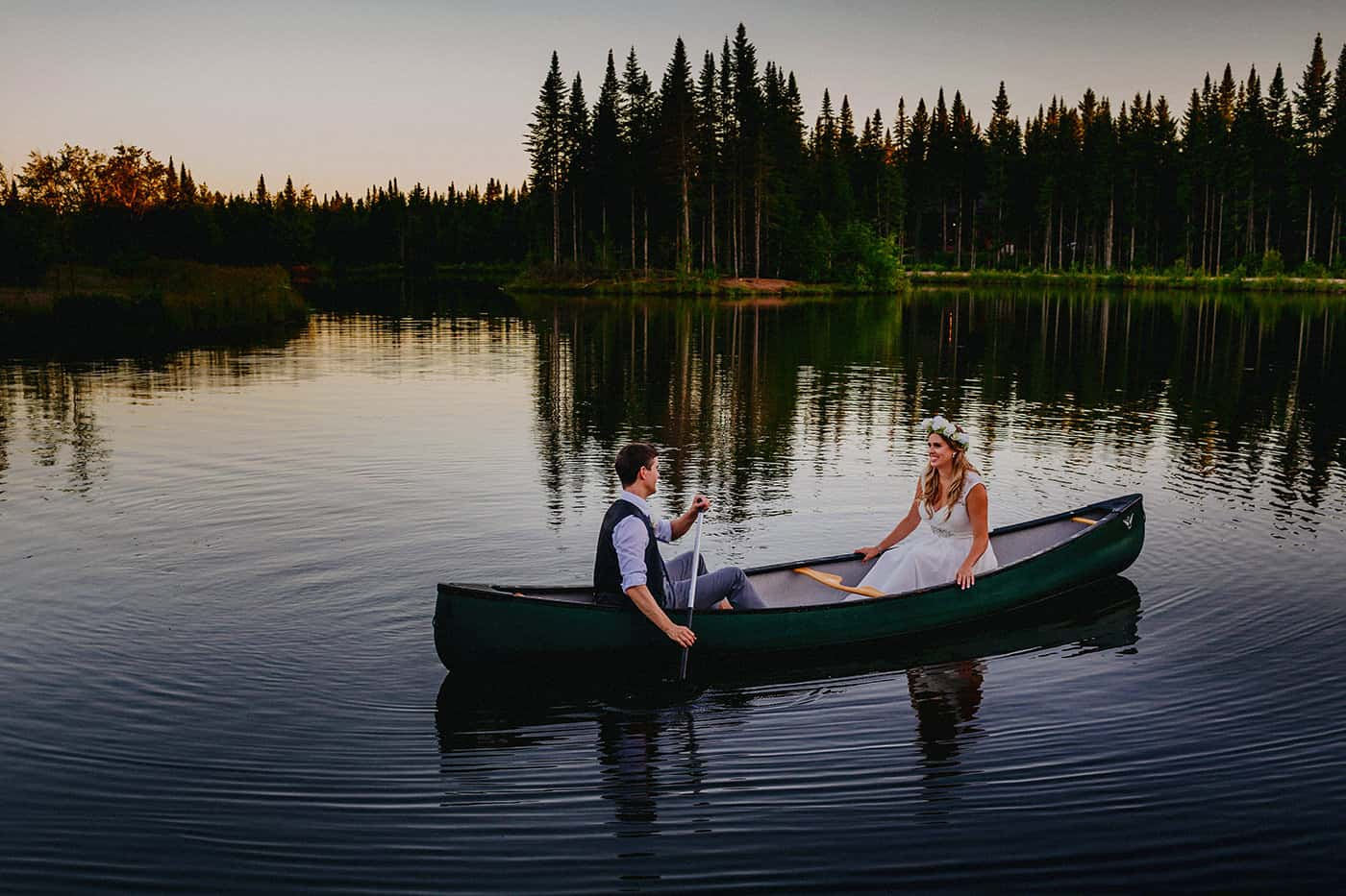 Bride & groom in canoe in Quebec