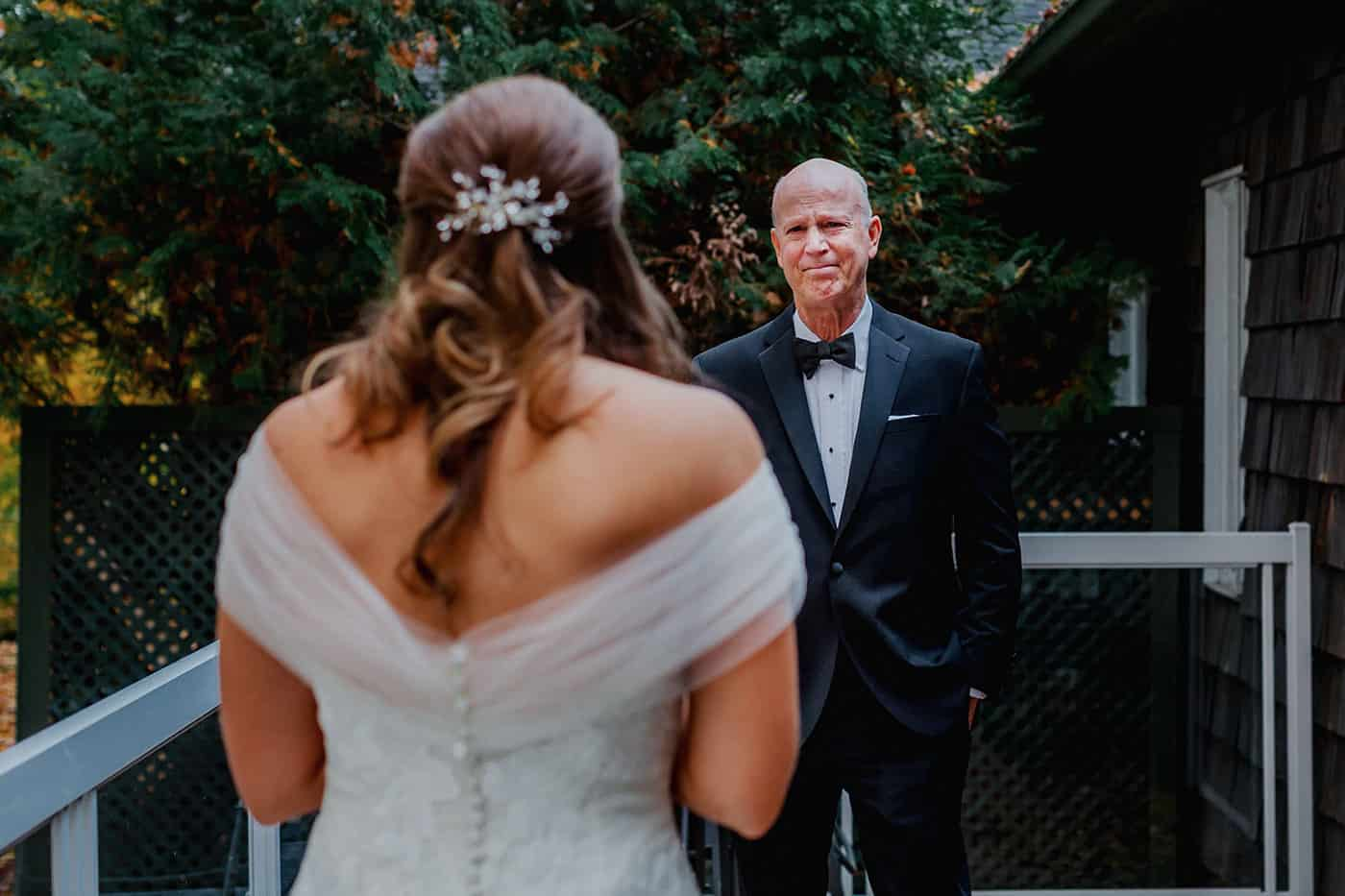 A father sees his daughter in her wedding dress