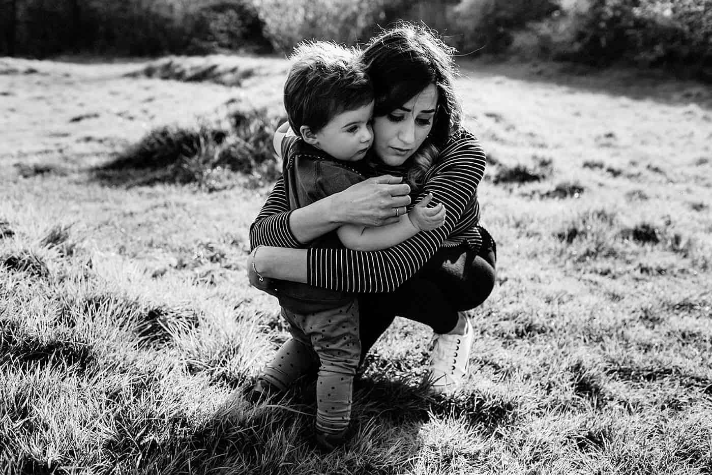 Mother gives son a comforting hug