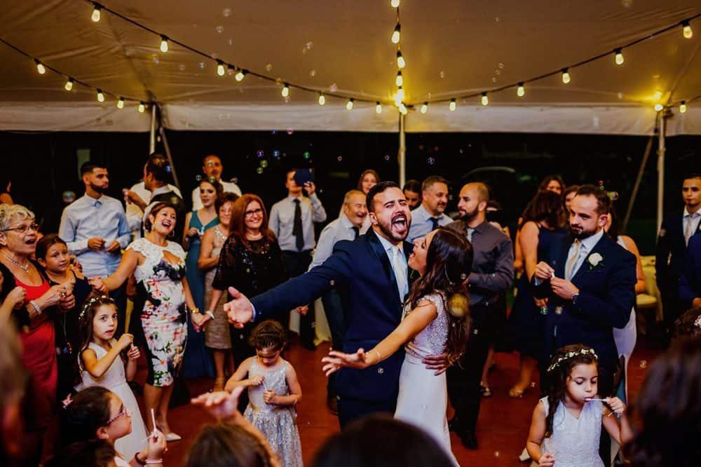 Bride & groom celebrate with guests on the dancefloor